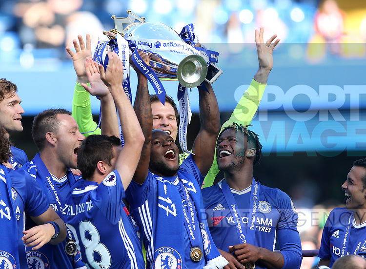 Chelsea's Victor Moses celebrates with the trophy during the Premier League match at Stamford Bridge Stadium, London. Picture date: May 18th, 2017. Pic credit should read: David Klein/Sportimage