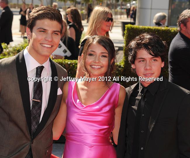 LOS ANGELES, CA - SEPTEMBER 15: Luke Bilyk, Cristine Prosperi and Ricardo Hoyos. arrive at the 2012 Primetime Creative Arts Emmy Awards at Nokia Theatre L.A. Live on September 15, 2012 in Los Angeles, California.