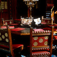 Chairs designed by A W N Pugin and made by Philip Webb are grouped around an hexagonal writing table