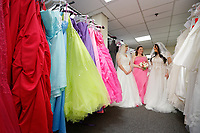 "COPY BY TOM BEDFORD<br /> Pictured L-R: Members of staff Sara Morris, Michelle Curry and Lara Williams, who have been trying on some of the dresses at the John Pye Auctions warehouse in Pyle, south Wales, UK.<br /> Re: A bride cried tears of joy after her missing wedding dress was found among a pile of 20,000 gowns in a warehouse.<br /> Meg Stamp, 27, paid £1,300 for the beautiful ivory lace dress but it  was seized by liquidators after a bridal company went bust.<br /> It was boxed up along with 20,000 others and due to be sold for a knock-down price at auction.<br /> But determined Meg banged on the auctioneer door saying: ""I want my dress back"".<br /> Staff at John Pye auctioneers in Port Talbot spent three hours sifting through boxes until they finally found Meg's dream dress."