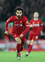 2nd January 2020; Anfield, Liverpool, Merseyside, England; English Premier League Football, Liverpool versus Sheffield United; Mohammed Salah of Liverpool races after the ball - Strictly Editorial Use Only. No use with unauthorized audio, video, data, fixture lists, club/league logos or 'live' services. Online in-match use limited to 120 images, no video emulation. No use in betting, games or single club/league/player publications