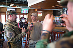 Murdoch Pizgatti, a member of Don't Comply Texas, interviews Pete Lanteri, a protestor participating in counter Jade Helm 15 observations at a bar in Bastrop, Texas.