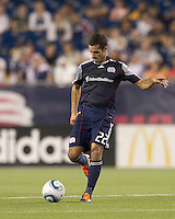 New England Revolution midfielder Benny Feilhaber (22) passes the ball. In a Major League Soccer (MLS) match, the New England Revolution tied Houston Dynamo, 1-1, at Gillette Stadium on August 17, 2011.