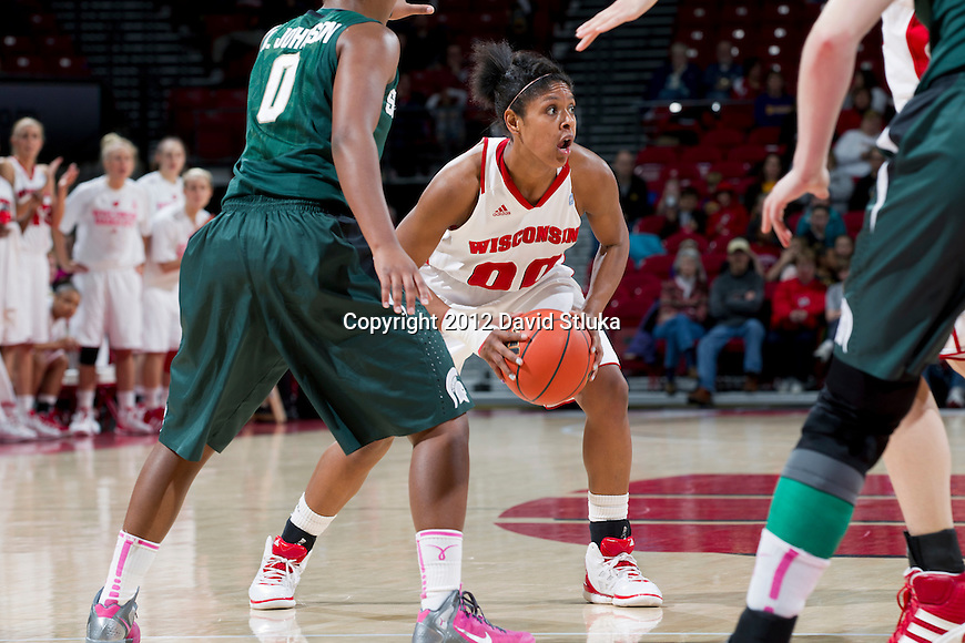 Wisconsin Badgers guard Jade Davis (00) handles the ball during a Big Ten Conference NCAA college women's basketball game against the Michigan State Spartans on Thursday, February 16, 2012 in Madison, Wisconsin. Michigan State won 62-46. (Photo by David Stluka)