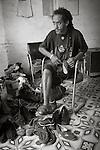 Havana, Cuba: Cobbler in the Regla neighborhood of Havana