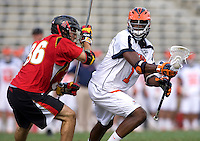 Shamel Bratton (1) of Virginia is defended by Jesse Bernhardt (36) of Maryland during the ACC men's lacrosse tournament finals in College Park, MD.  Virginia defeated Maryland, 10-6.