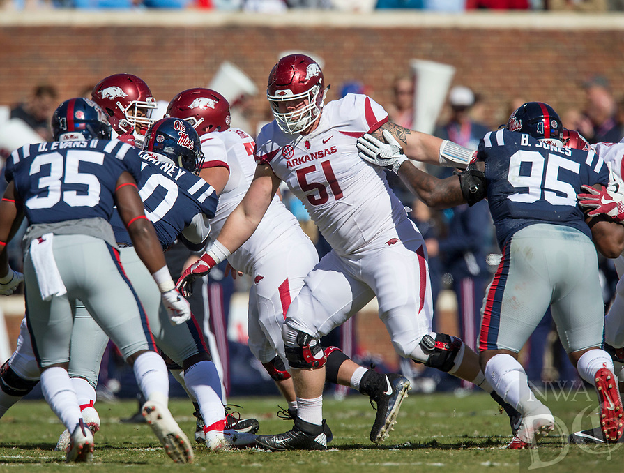 Hawgs Illustrated/BEN GOFF <br /> Hjalte Froholdt (51), Arkansas left guard, blocks in the first quarter against Ole Miss Saturday, Oct. 28, 2017, at Vaught-Hemingway Stadium in Oxford, Miss.