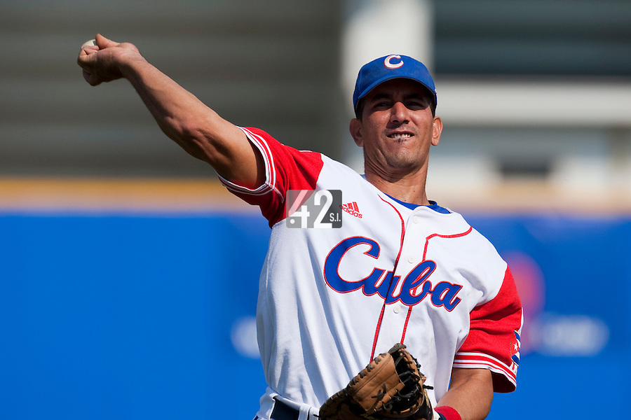 27 September 2009: Ariel Pestano of Cuba warms up prior to the 2009 Baseball World Cup gold medal game won 10-5 by Team USA over Cuba, in Nettuno, Italy.