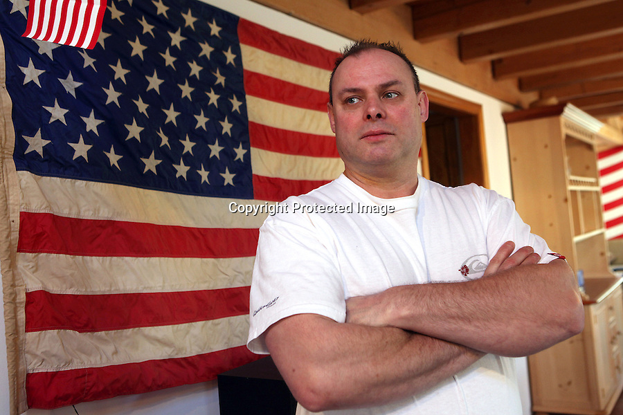 Bret Christopher is photographed in his home in Orleans, MA.  Christopher, who recently lost his business and is currently working as a dishwasher at a local restaurant, is benefitting from a home heating oil program.  Chrisrtopher uses a wood stove to heat his house.  01/12/10