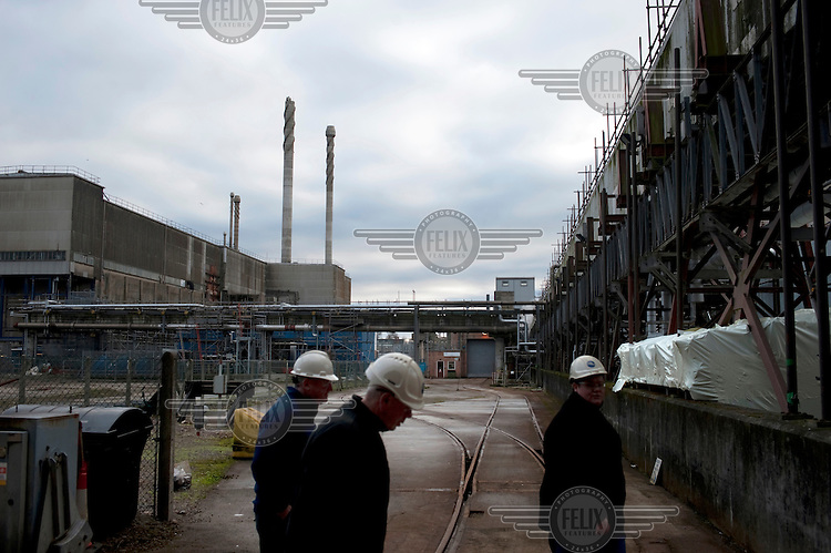 Workers stand in part of the Old 'Legacy' area of Sellafield nuclear power station that is undergoing decommissioning.
