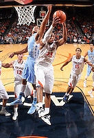 Virginia forward Akil Mitchell (25) grabs the rebound during an NCAA basketball game against Virginia Monday Jan. 20, 2014 in Charlottesville, VA. Virginia defeated North Carolina 76-61.