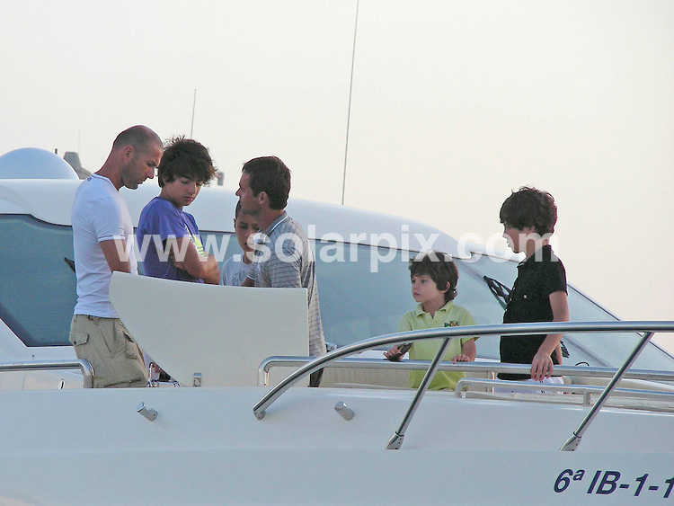 **ALL-ROUND PICTURES FROM SOLARPIX.COM**.**WORLD SYNDICATION RIGHTS EXCEPT BELGIUM, GERMANY, HOLLAND, SCANDINAVIA, SOUTH AMERICA, SPAIN, & USA**.French footballer Zinedine Zidane on holiday with his family in Ibiza, Spain. 2 August 2009..This pic: Zinedine Zidane..JOB REF: 9661 SKX      DATE: 02_08_2009.**MUST CREDIT SOLARPIX.COM OR DOUBLE FEE WILL BE CHARGED**.**MUST NOTIFY SOLARPIX OF ONLINE USAGE**.**CALL US ON: +34 952 811 768 or LOW RATE FROM UK 0844 617 7637**