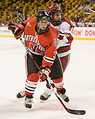 Ryan Ginand (NU - 3), Doug Rogers (Harvard - 15) - The Northeastern University Huskies defeated the Harvard University Crimson 3-1 in the Beanpot consolation game on Monday, February 12, 2007, at TD Banknorth Garden in Boston, Massachusetts.