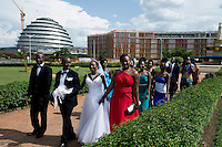 KIGALI, RWANDA NOVEMBER 8: A wedding party poses for pictures in a park outside the newly constructed Kigali Convention Complex on November 8, 2014 in central Kigali, Rwanda. The country is one of the fastest growing economies on the continent and new hotels, shopping malls, gated communities are being constructed around the city. (Photo by: Per-Anders Pettersson)