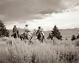 USA, Montana, cowboys and cowgirl sitting on horses, Gallatin National Forest, Emigrant (B&W)