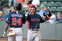 Center fielder Justin Dean (5) of the Rome Braves, a local Mauldin High School grad, is greeted by Henry Quintero after scoring a run in the first inning of a game against the Greenville Drive on Friday, June 28, 2019, at Fluor Field at the West End in Greenville, South Carolina. Rome won, 4-3. (Tom Priddy/Four Seam Images)