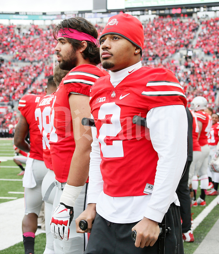 Injured player Ohio State Buckeyes cornerback Marshon Lattimore (2) watches from the sideline during Saturday's NCAA Division I football game between the Ohio State Buckeyes and the Rutgers Scarlet Knights at Ohio Stadium in Columbus on Oct. 18, 2014. (Dispatch Photo by Barbara J. Perenic)