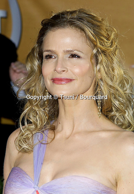 Kyra Sedgwick arriving at the 11th annual Screen Actors Guild Awards at the Shrine Auditorium in Los Angeles. February 5, 2005.