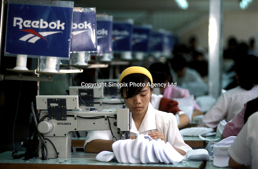Factory workers at Reebok production line at a factory in Zhuhai, China.