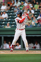 Second baseman Yoan Moncada (24) of the Greenville Drive bats in a game against the Charleston RiverDogs on Monday, June 29, 2015, at Fluor Field at the West End in Greenville, South Carolina. The Cuban-born 19-year-old Red Sox signee has been ranked the No. 1 international prospect in baseball by Baseball America. Greenville won, 4-2. (Tom Priddy/Four Seam Images)