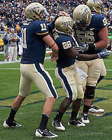 Pittsburgh running back Dion Lewis (28) celebrates a touchdown with teammates Joe Thomas (56) and  Bill Stull (11). The Pittsburgh Panthers defeated the South Florida Bulls 41-14 at Heinz Field, Pittsburgh, PA on October 24, 2009.