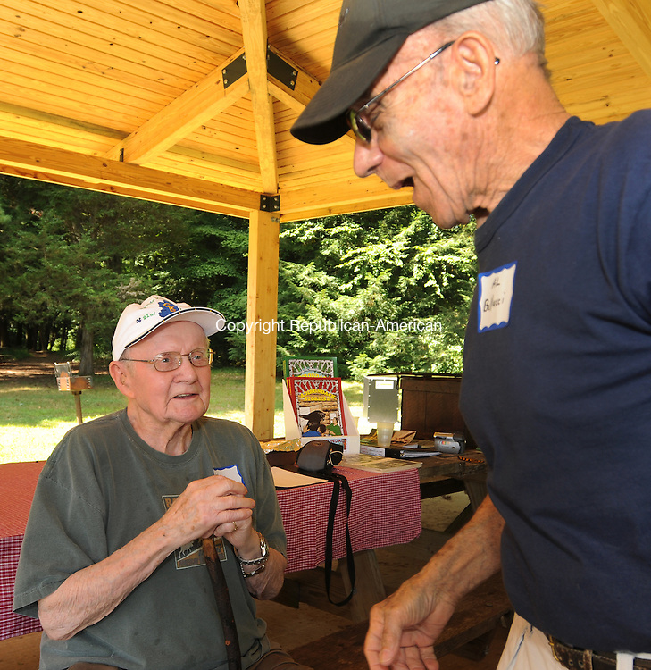 WATERTOWN, CT 31  JULY, 2010-073110JS04-Civilian Conservation Corps members Ed Kelly of Woodbury who worked in the Windsor Camp and Triangle Lake in Oregon, left, talks with, Al Bellucci of Waterbury who worked in Camp Mohawk during a reunion of CCC workers Saturday at Black Rock State Park in Watertown. The Civilian Conservation Corps was a New Deal program that hired more than 3 million men to plant more than 3 billion trees and do other forestry work from 1933-1942. According to Marty Podskoch of Colchester, who wrote about the Connecticut CCC, the state had 22 CCC camps which enrolled about 28,500 men. The group will will have another gathering of CCC workers on September 18 at the Civilian Conservation Corps museum at Shenipsit State Forest in Stafford. For more information or if you have stories about the CCC, contact Marty Podskoch at www.cccstories.com.<br /> Jim Shannon Republican-American