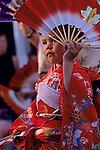 Young girl dancing with fan at the Bon Odori celebration Seattle Washington State USA