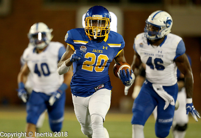 BROOKINGS, SD, OCTOBER 6: Pierre Strong, Jr. #20 from South Dakota State University breaks loose for a big gain past Katrell Moss #40 and Jonas Griffith #46 from Indiana State during their game Saturday night at Dana J. Dykhouse Stadium in Brookings. (Dave Eggen/Inertia)