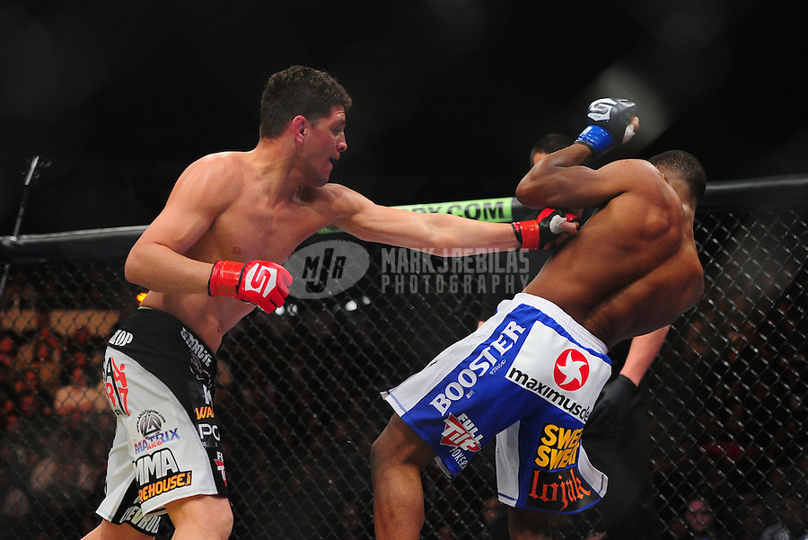 Apr. 9, 2011; San Diego, CA, USA; Strikeforce welterweight world championship fighter Nick Diaz (left) against Paul Daley during a bout at the Valley View Casino Center. Diaz defeated Daley in the first round.  Mandatory Credit: Mark J. Rebilas-