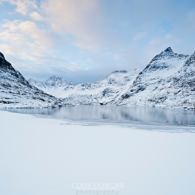 Partially frozen lake Ågvatnet in winter, Å I Lofoten, Lofoten Islands, Norway