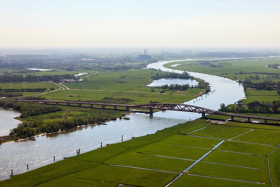 Nederland, Gelderland - Overijssel, Hattem, 01-05-2013; IJsselbrug, spoorbrug bij Hattem voor de Hanzelijn. IJssel en IJsselcentrale in de achtergrond.<br /> De 'Hanzeboog' is ontworpen door  Quist Wintermans Architecten.<br /> The red railway bridge Hanzeboog (Hanseatic arch) over the IJssel near Zwolle, has been designed by Quist Wintermans Architects.<br /> luchtfoto (toeslag op standard tarieven);<br /> aerial photo (additional fee required);<br /> copyright foto/photo Siebe Swart
