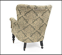 BNPS.co.uk (01202 558833)<br /> Pic: Bonhams/BNPS<br /> <br /> ***Please use full byline***<br /> <br /> A Victorian armchair specially made for the Elephant Man to support the weight of large tumours covering his head is expected to fetch &pound;1,500 at auction.<br /> <br /> Joseph Merrick suffered from horrific growths on his body and earnt a living working in freak shows and circuses in the 19th century, where he was often abused by members of the public.<br /> <br /> Merrick was rescued from a lifetime of ridicule by Dr Frederick Treves in 1886, and he was taken to the London Royal Hospital.<br /> <br /> It is thought that while he was a worker at the hospital he had an armchair custom made for him so that he could comfortably rest his enlarged skull.<br /> <br /> The seat, made from ebonised wood and fabric, had been built so that the back permanently reclined at 45 degrees instead of being traditionally upright.