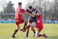 Jason Harries of London Scottish looks for a way through during the Greene King IPA Championship match between London Scottish Football Club and Jersey at Richmond Athletic Ground, Richmond, United Kingdom on 18 February 2017. Photo by David Horn / PRiME Media Images.