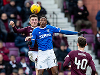 26th January 2020, Tynecastle Park, Edinburgh, Scotland; Scottish Premier League football, Hearts of Midlothian versus Rangers; Jon Souttar of Hearts and Joe Aribo of Rangers challenge for the header