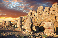 Pictures of the statues of around the tomb of Commagene King Antochus 1 on the top of Mount Nemrut, Turkey. Stock photos & Photo art prints. In 62 BC, King Antiochus I Theos of Commagene built on the mountain top a tomb-sanctuary flanked by huge statues (8–9 m/26–30 ft high) of himself, two lions, two eagles and various Greek, Armenian, and Iranian gods. The photos show the broken statues on the  2,134 m (7,001 ft)  mountain. 5