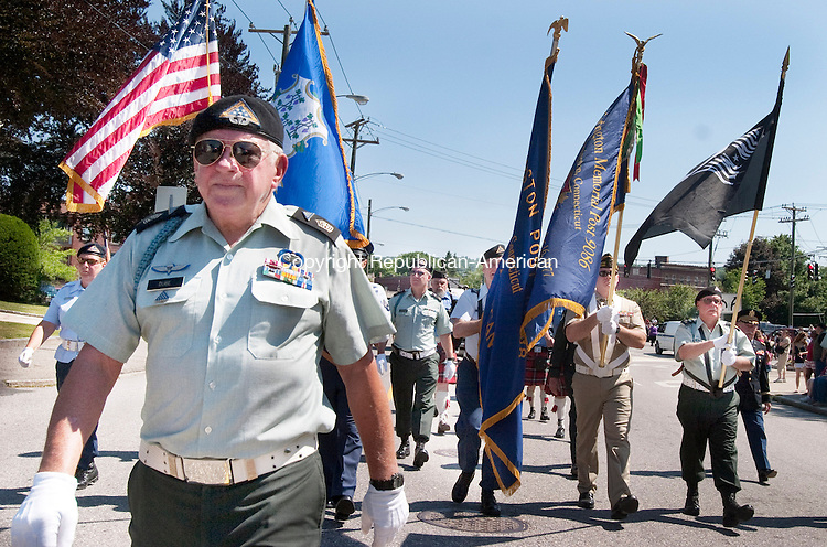 TORRINGTON CT. 31 May 2010-053110SV10--Sgt. Major Len Dube of the Torrington Veterans Service Office, left, lead the color guard and all the marchers during the Memorial Day Parade in Torrington Monday. <br /> Steven Valenti Republican-American