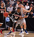 OMAHA, NE - FEB 28: University of Nebraska Omaha CJ Carter (10) attempts to drive around Zach Horstman (24) of South Dakota State during the second half of their game on Thursday at Ralston Arena in Omaha, NE. (Photo By Ty Carlson for Dakota Press)