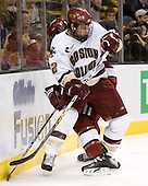 JD McCabe (Harvard University - Jamison, PA) and Ben Smith (Boston College - Avon, CT) battle on the boards. The Boston College Eagles defeated the Harvard University Crimson 3-1 in the first round of the 2007 Beanpot Tournament on Monday, February 5, 2007, at the TD Banknorth Garden in Boston, Massachusetts.  The first Beanpot Tournament was played in December 1952 with the scheduling moved to the first two Mondays of February in its sixth year.  The tournament is played between Boston College, Boston University, Harvard University and Northeastern University with the first round matchups alternating each year.