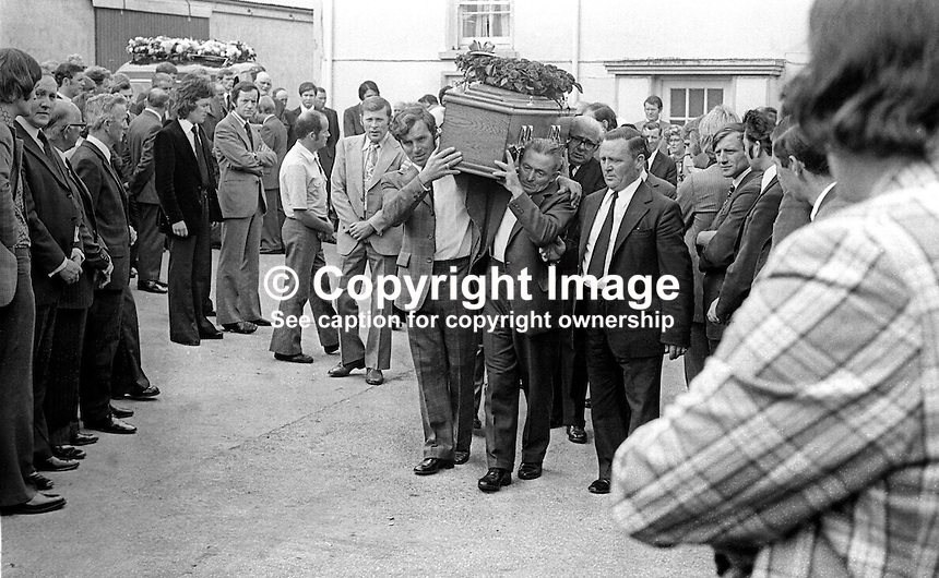 Funeral cortege of Brian McCoy, trumpeter, one of three members of the Miami Show Band, who died in a UVF attack as the band was travelling back to Dublin after appearing in Banbridge, leaves from his family home in Caledon, Co Tyrone, N Ireland, 2nd August 1975. 197508020595c<br />