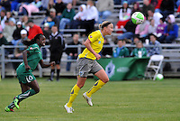 Sara Larsson pursued by Eniola Aluko...Saint Louis Athletica defeated Philadelphia Independence 2-1 at Anheuser-Busch Soccer Park, Fenton, MO.