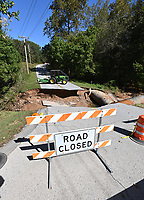 NWA Democrat-Gazette/SPENCER TIREY  A section of Highland Road is washed out at the intersection of Chelsea Road, Monday, Oct. 7 2019, after flooding from Sunday's storm.