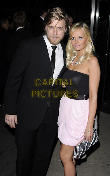 JONATHAN ANSELL & DEBBIE KING .At the Variety Club Annual Dinner & Ball, London Hilton Hotel, Park Lane, London, England, UK, March 13th 2010..half bandeau top skirt  length black suit tie strapless pink dress couple beard facial hair silver clutch bag .CAP/CAN.©Can Nguyen/Capital Pictures