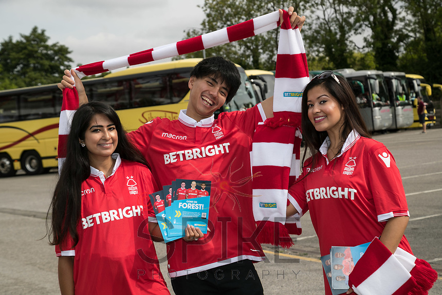 Cheering on Forest from left are Manpreet Kaur, Fadlan Effendi and Gurpreet Kaur