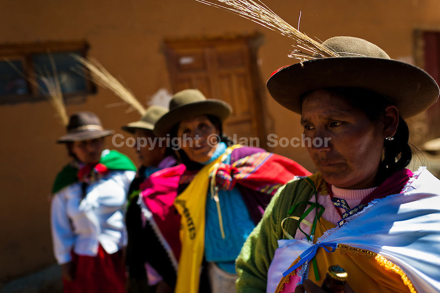 Peruvian indigenous women celebrate the Yawar Fiesta, a ritual fight between the condor and the bull, held in the mountains of Apurímac, Cotabambas, Peru, 30 July 2012. The Yawar Fiesta (Feast of Blood), an indigenous tradition which dates back to the time of the conquest, consists basically of an extraordinary bullfight in which three protagonists take part - a wild condor, a wild bull and brave young men of the neighboring communities. The captured condor, a sacred bird venerated by the Indians, is tied in the back of the bull which is carefully selected for its strength and pugnacity. A condor symbolizes the native inhabitants of the Andes, while a bull symbolically represents the Spanish invaders. Young boys, chasing the fighting animals, wish to show their courage in front of the community. However, the Indians usually do not allow the animals to fight for a long time because death or harm of the condor is interpreted as a sign of misfortune to the community.