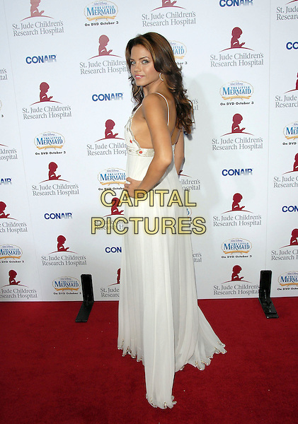 JENNA DEWAN.Attends Runway for Life, Benefiting St. Jude Children's Research Hospital held at The Beverly Hilton Hotel in Beverly Hills, California, USA, September 15th 2006..full length white dress hand on hip shoulder back.Ref: DVS.www.capitalpictures.com.sales@capitalpictures.com.©Debbie VanStory/Capital Pictures