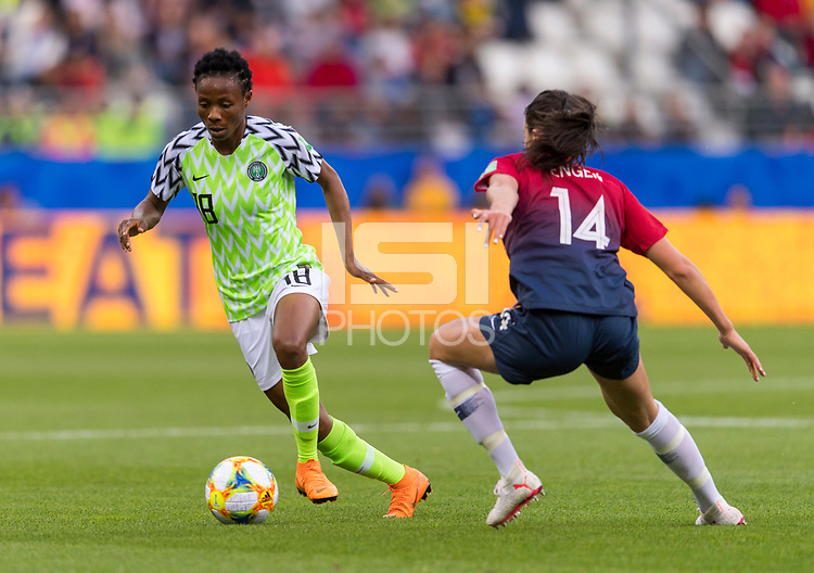 REIMS, FRANCE - JUNE 08: Halimatu Ayinde #18 dribbles past Ingrid Syrstad Engen #14 during a game between Norway and Nigeria at Stade Auguste-Delaune on June 8, 2019 in Reims, France.
