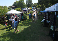 NWA Democrat-Gazette/J.T. WAMPLER Visitors look over art for sale during the Fall Music & Art Festival Sunday Sept 8, 2019 at Terra Studios near Durham. The annual fundraiser featured 20 artists with booths set up around the grounds, and song circles with music from many genres. There were also art demonstrations and food trucks. For more information about events at Terra Studios visit https://terrastudios.com/