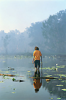 Clarissa Ngakyunkwokka, Winchanam Clan group, in wetlands, Aurukun, Cape York Peninsula.