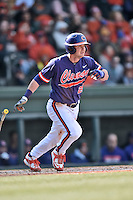 Clemson Tigers left fielder Reed Rohlman (26) swings at a pitch during a game against the South Carolina Gamecocks at Fluor Field February 28, 2015 in Greenville, South Carolina. The Gamecocks defeated the Tigers 4-1. (Tony Farlow/Four Seam Images)