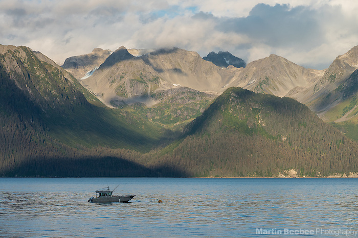 Fishing boat below mountains on Resurrection Bay, Seward, Alaska